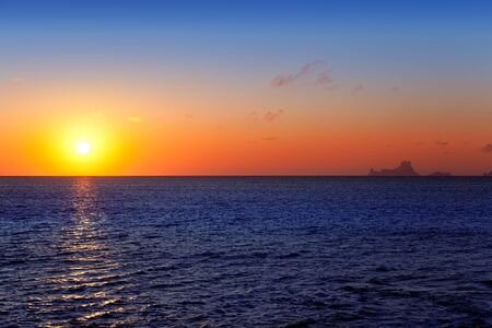 vedra: Balearic sunset from La Savina in Formentera with Es Vedra of Ibiza in background Stock Photo