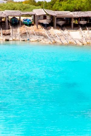 formentera: Es Calo de San Agusti port in Formentera island beached boats with wood rails Editorial