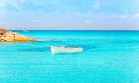 Es Calo de San Agusti with boat in Formentera island turquoise mediterranean Stock Photo - 14262774