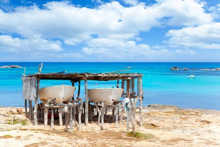 Beached boats in Formentera Els Pujols beach with turquoise water photo
