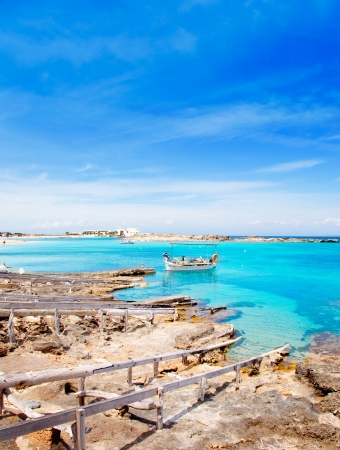 Els Pujols beach in Formentera with traditional fishing boat in summer day
