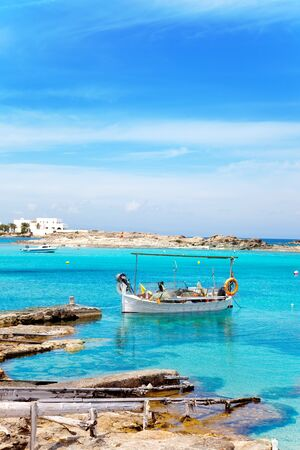pujols: Els Pujols beach in Formentera with traditional fishing boat in summer day