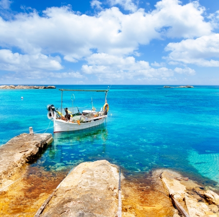 Els Pujols beach in Formentera with traditional fishing boat in summer day Stock Photo - 14285835