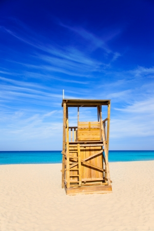 Formentera Llevant beach lifeguard house in white sand and turquoise idyllic water photo
