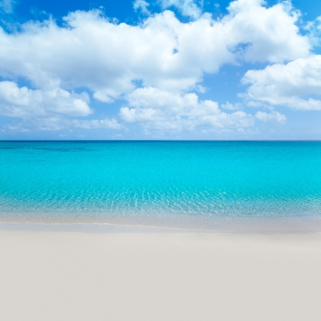 perfect waves: beach tropical with white sand and turquoise water under blue sky Stock Photo