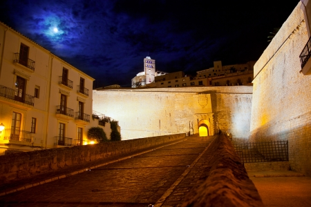 ibiza: Eivissa Ibiza town with night moon castle entrance and Church