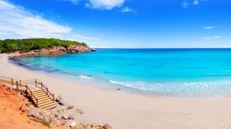 Cala Nova beach in Ibiza island with turquoise water in Balearic Mediterranean