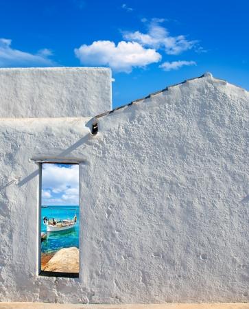 view through door: Balearic islands idyllic turquoise beach view through whitewashed house open door