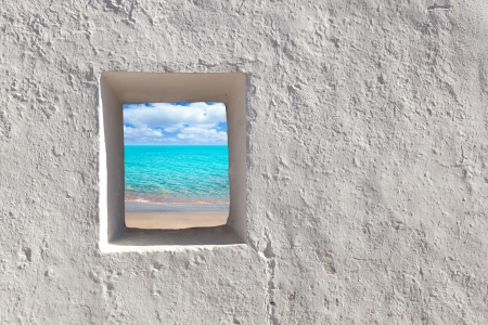 view through door: Balearic islands idyllic turquoise beach view through whitewashed house open door