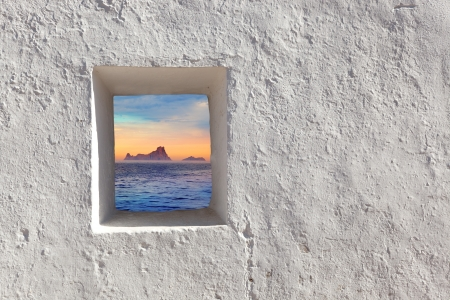 Balearic islands Es Vedra sunset view through whitewashed window photo