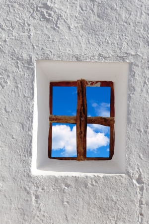 Balearic islands blue sky view through whitewashed house window photo