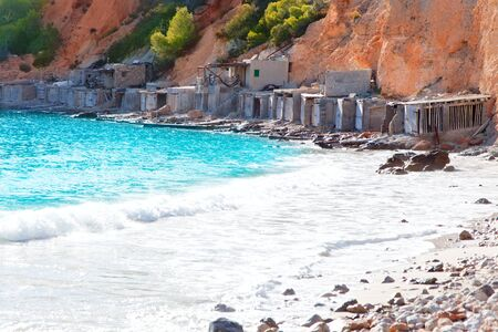 beached: Cala d Hort Ibiza beach with traditional wood boat mooring in Balearic island Editorial