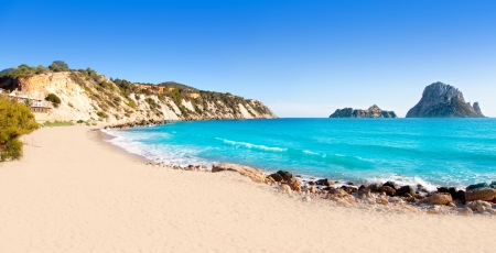 beaches of spain: Es vedra island of Ibiza view from Cala d Hort in Balearic islands Stock Photo