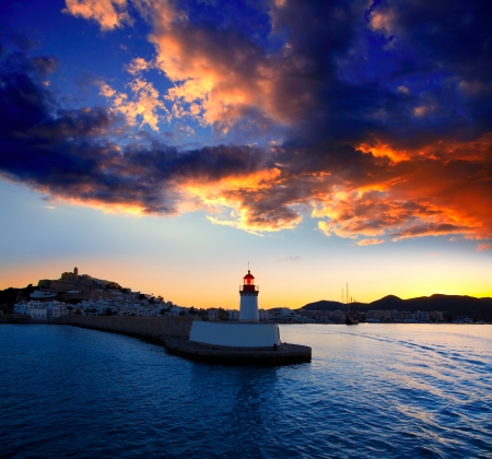 Eibissa Ibiza town sunset from red lighthouse beacon in port photo