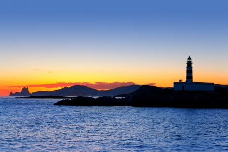 formentera: Ibiza island sunset with freus lighthouse and Es Vedra in background