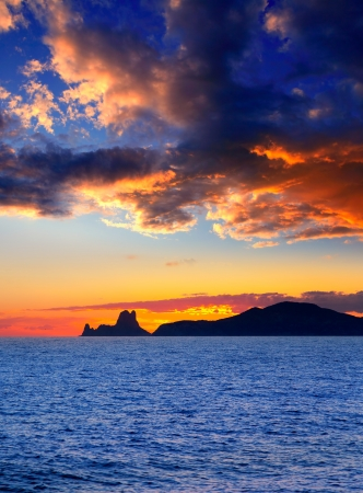 es: Ibiza island sunset with Es Vedra in background at Balearic islands Stock Photo