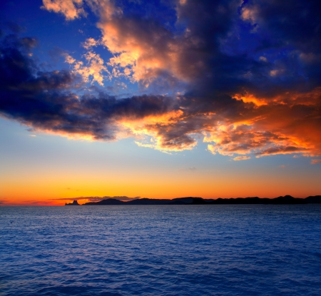 vedra: Ibiza island sunset with Es Vedra in background at Balearic islands Stock Photo