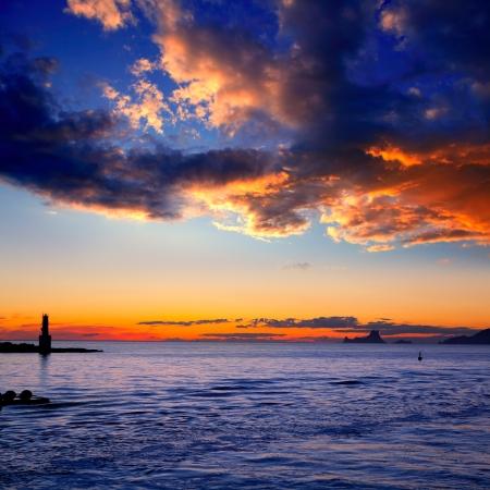 es: Ibiza island sunset of Es Vedra and La  Savina lighthouse in Formentera