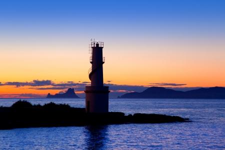 vedra: Ibiza island sunset of Es Vedra and La  Savina lighthouse in Formentera