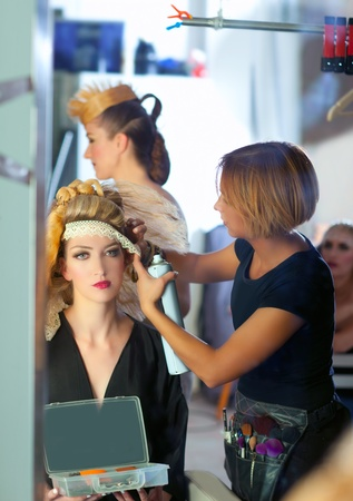 backstage hairdressing and makeup fashion with make-up artist photo