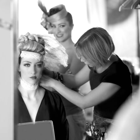 combed: backstage hairdressing and makeup fashion with make-up artist Stock Photo