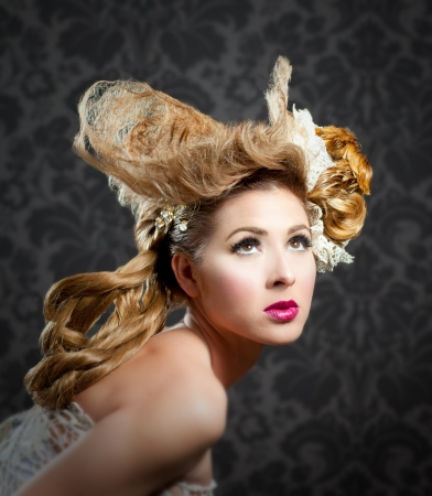 Hairdressing and makeup fashion woman on dark background Stock Photo