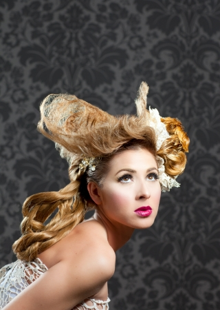 Hairdressing and makeup fashion woman on dark background photo