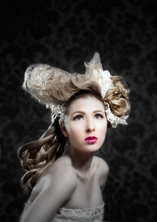 victorian lady: Hairdressing and makeup fashion girl on dark background Stock Photo