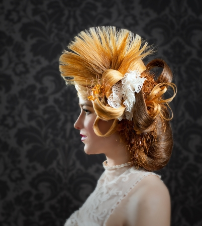 victorian lady: Hairdressing and makeup fashion woman on dark background Stock Photo