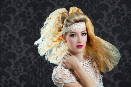 combed: Hairdressing and makeup fashion woman on dark background Stock Photo