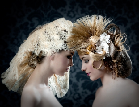 combed: Hairdressing and makeup fashion two woman on dark background Stock Photo
