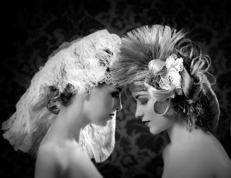victorian lady: Hairdressing and makeup fashion two woman on dark background Stock Photo