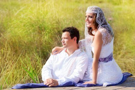 Couple mediterranean wedding day fashion in outdoor nature photo