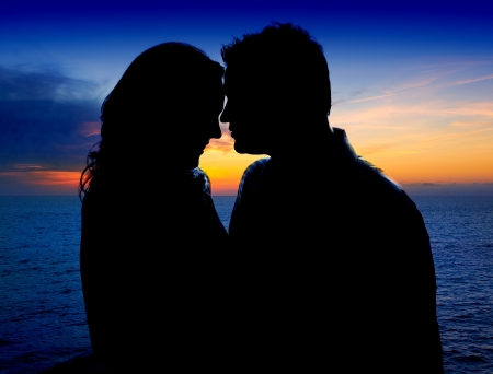 Couple in love hug in sunset on sea lake photo