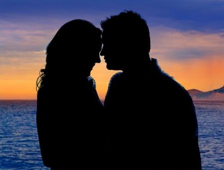 Couple in love hug in sunset on sea lake photo