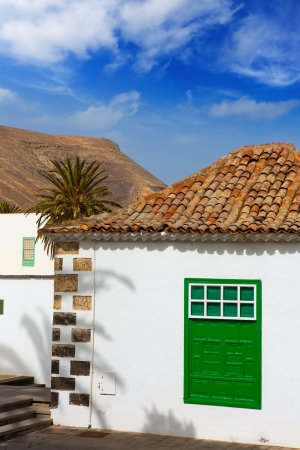 canarian: Lanzarote Yaiza white village houses green window in Canary Islands
