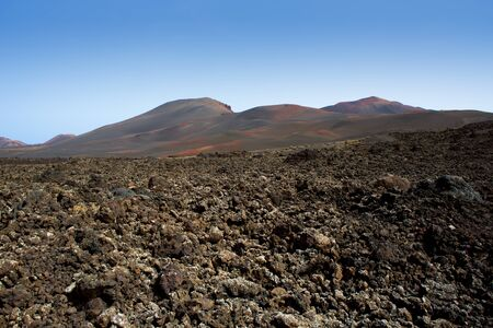 stone volcanic stones: Lanzarote Timanfaya National Park Fire Mountains volcanic lava stone In Canary Islands