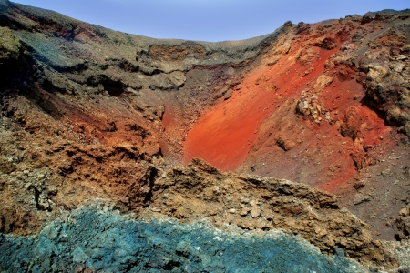 red soil: Lanzarote Timanfaya colorful lava stone texture  canary Islands Stock Photo