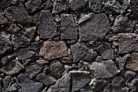 stone volcanic stones: Lanzarote lava stone black masonry wall in Canary Islands Stock Photo