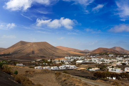 lanzarote: Lanzarote Yaiza white houses village under volcanic mountains of Canary Islands