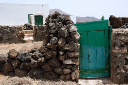 golfo: Lanzarote typical rural white house green door in Canary Islands