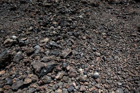 Black volcanic stones soil texture in Lanzarote photo
