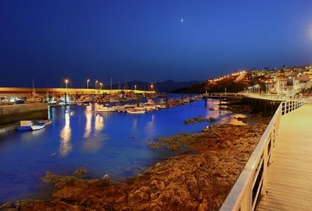 carmen: Lanzarote Puerto del Carmen harbour night view in Canary Islands Stock Photo