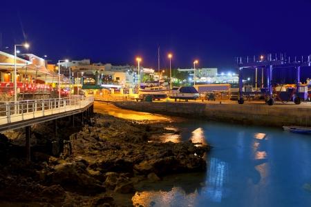 lanzarote: Lanzarote Puerto del Carmen harbour night view in Canary Islands Stock Photo