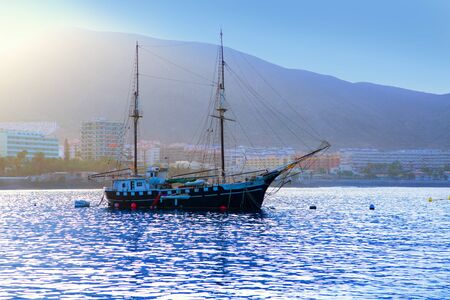 arona: Los Cristianos harbor port sailboat sunrise in Adeje coast Arona Tenerife