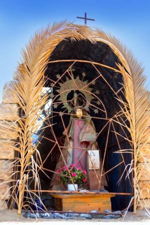 blessed virgin mary: Adeje Costa El Puertecito Virgin in palm tree cave at Tenerife Stock Photo