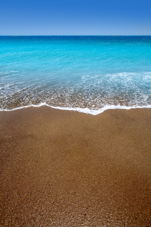 sand beach: Canary Islands brown sand beach and tropical turquoise water Stock Photo