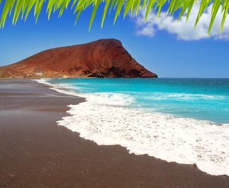 red mountain: Beach Playa de la Tejita turquoise in Tenerife Canary islands with red mountain