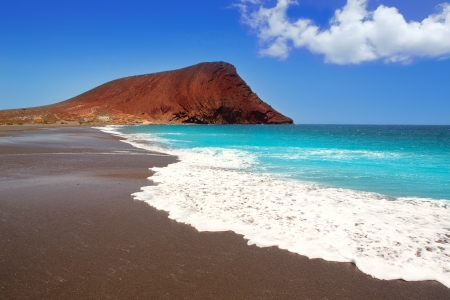 tenerife: Beach Playa de la Tejita turquoise in Tenerife Canary islands with red mountain
