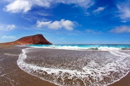 briny: Beach Playa de la Tejita turquoise in Tenerife Canary islands with red mountain